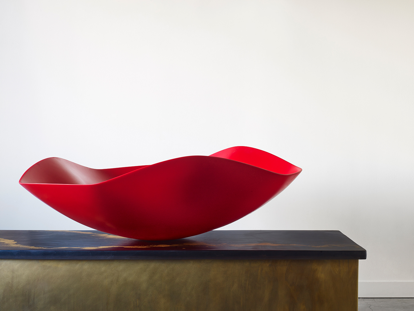 red resin bowl that's handmade
