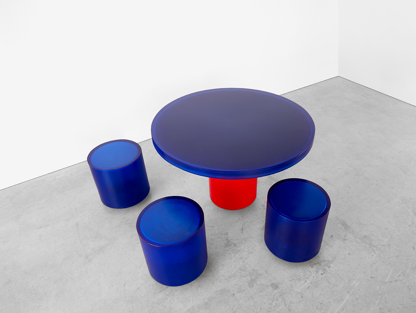 blue and red round resin dining table