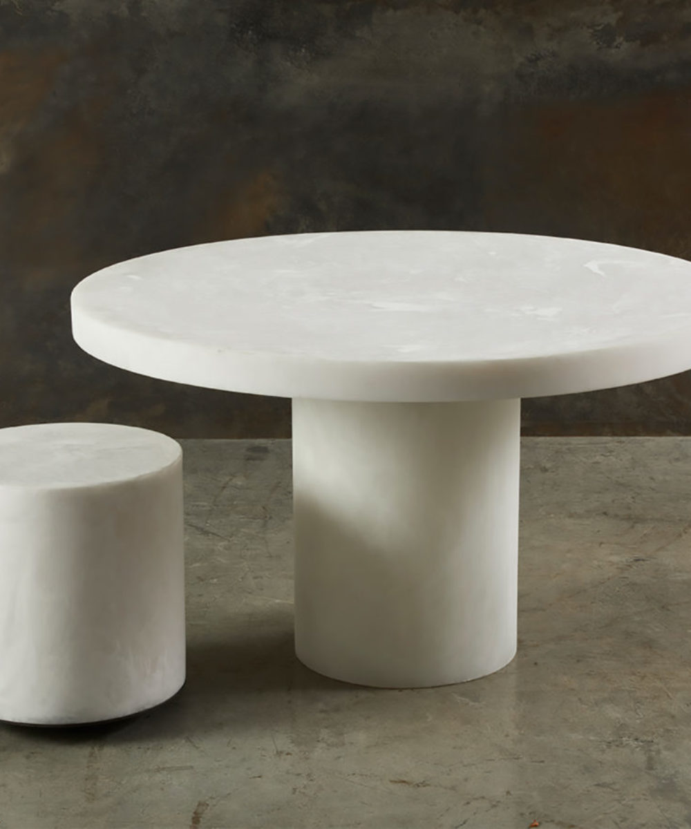 white round resin dining table with stool