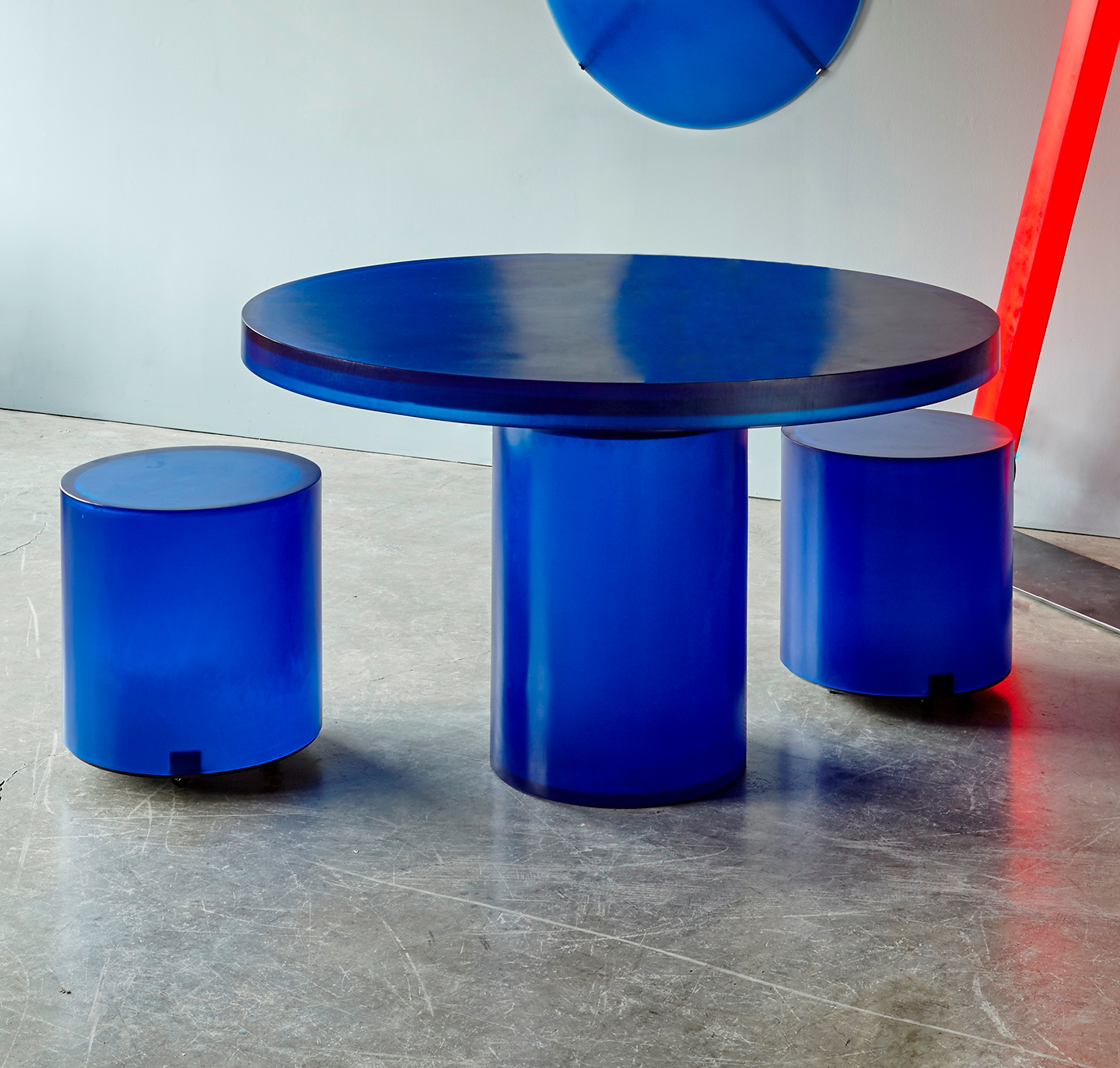 blue round resin dining table