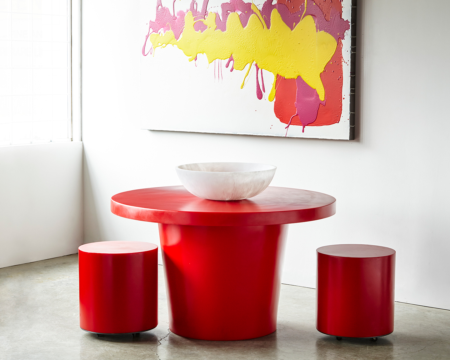 a red round resin dining table