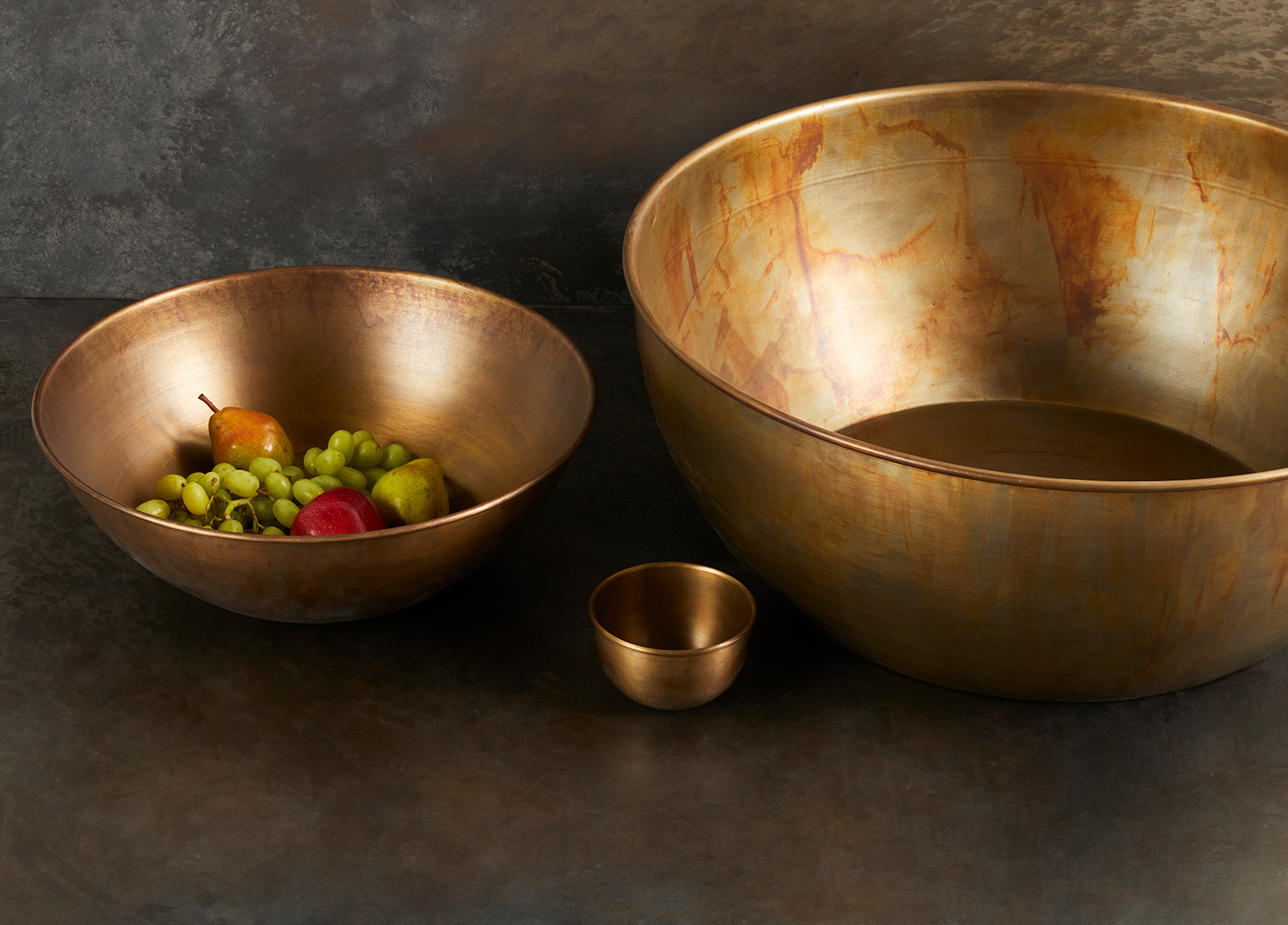 different sized brass bowls