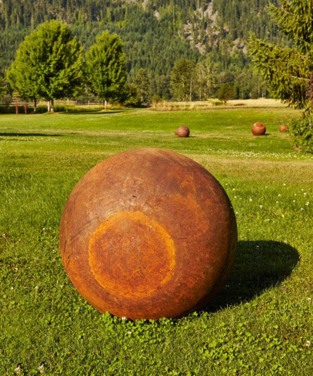 Lunar Steel Balls in Grass Field